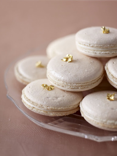 Dress these lovely pearlized macaroons with edible gold leaf for an unexpected embellishment. (Martha Stewart Weddings)