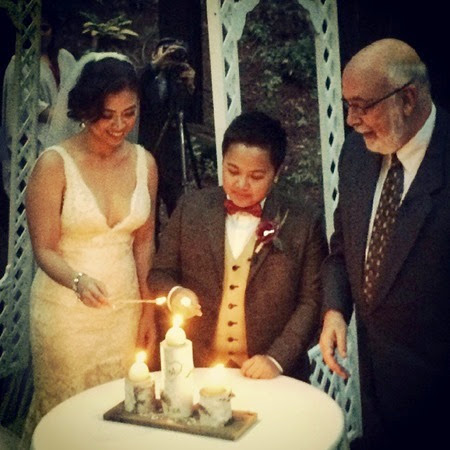 Liza and Aiza lighting their unity candle