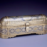 "Pen box with hinged inkwell, inscribed with a prayer in the form of the tŭgra (imperial Ottoman monogram) and the phrase ""He [God] is."" Turkey, ca. 1850. Steel overlaid with silver and gold. 9.6 x 2.2 x 3.8 in. (24.5 x 5.5 x 9.6). Private collection"