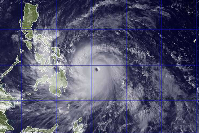 This satellite image provided by the U.S. Naval Research Lab shows Typhoon Haiyan as it tracked toward the Philippines on 7 November 2013. Photo: US Naval Research Lab / Associated Press