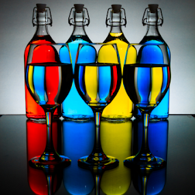 Rainbow Cocktail by MIGUEL CORREA - Artistic Objects Glass ( lights, water, backlit, color, cognac, glass, still, bottles, bottle, bokeh )
