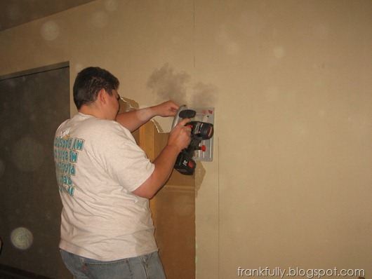 demo: cutting out the drywall