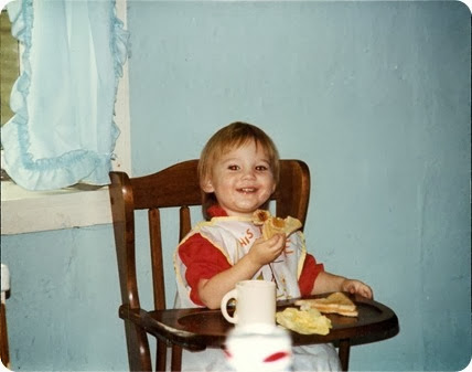 Andrea with sandwich in highchair