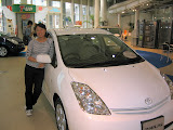 Maria with her favorite car in the Megaweb showroom