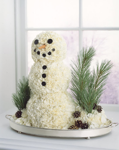 I love this crafty snowman made from carnations.