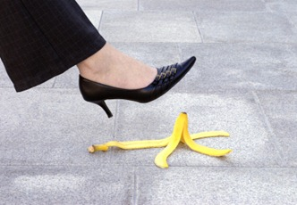 Female executive and banana skin