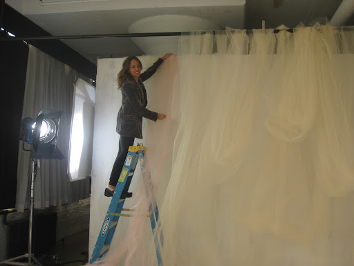 Melissa hanging some tulle and testing out the soft colors together