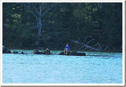 one lone boy on rocks