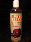 Burt's Bees scores 2 + 2 + 3 + 1 = 8.  It's a 99% natural alternative to conventional shampoos at a nice price, with eco-friendly packaging to boot. ($8 for 12oz)