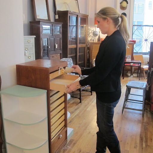 Decorating & Home Editor Rebecca Robertson inspects the drawers of a very unique wooden piece that we both loved.