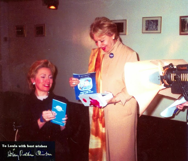 Hillary Clinton US First Lady holding OA ticket with Loula Loi Alafoyiannis.jpg