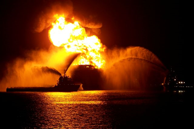 The Deepwater Horizon oil rig burns in the night. Photo: Matt Milbury / Piping Designer