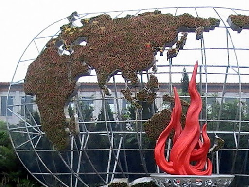 Globe with flame-like statue shown in August 2008 in Beijing's T-Square.