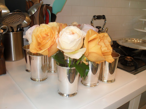 If you put your roses in a cylender vase, they would stand up straight and it wouldn't show off the roses' faces.