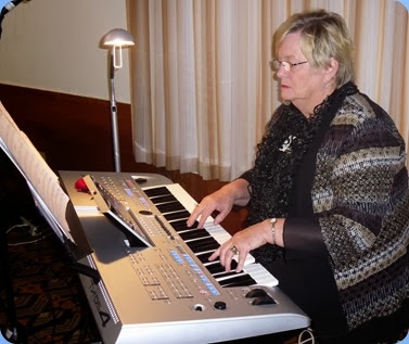 Barbara McNab played the arrival music and a mini-concert on her Yamaha Tyros 4. Photo courtesy of Dennis Lyons.