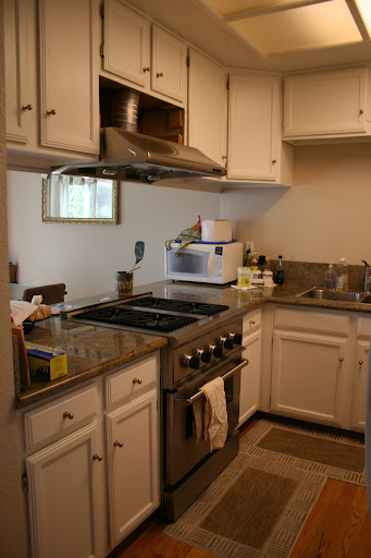 Kitchen with granite counter top and Thermadore gas range. The kitchen opens to the dining area.
