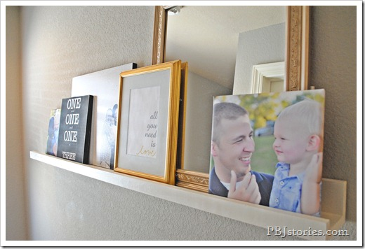 Layering pictures on shelf