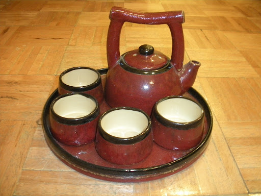 An earthenware ceramic tea set in a beautiful ruby hue.