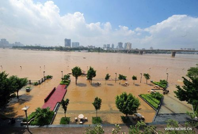 Photo taken on 20 August 2012 shows flooded waterfronts along the Yongjiang River in Nanning, capital of South China's Guangxi Zhuang Autonomous Region. Heavy rainstorms triggered by Typhoon Kai-Tak slashed Nanning, raising the water level of Yongjiang River and flooding some waterfronts. Xinhua