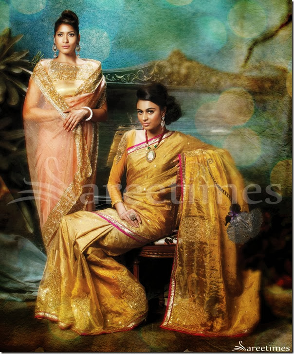 LD-32: This peach glass tissue saree is encrusted with sparkling kundans, bugle beads and nakshi and is couple with an equally embellished blouse. The sequin and stone studded border gives a royal retreat to this masterly crafted piece. Small circular motifs are scattered throughout its body to add a dash of bling.LD-33: This half & half gold woven saree represents the perfect blend of jute and tissue. The border is outlined with lurex lace and a contrast Dupion fabric. Bold Gota Patti floral motifs accentuate the bottom half of the drape.