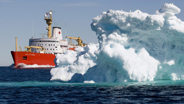 The Canadian Coast Guard icebreaker Louis S. St-Laurent sails past an iceberg in Lancaster Sound on 11 July 2008. Jonathan Hayward / Canadian Press