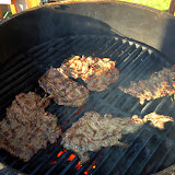 The carne hits the grill.