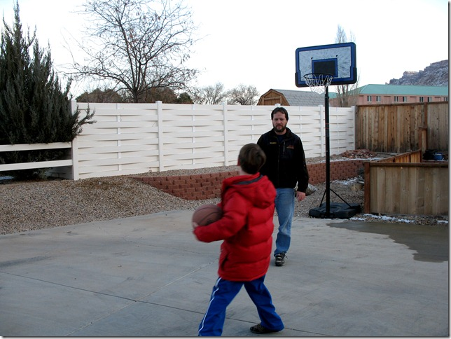 2011 12 26_Aidan and Bri playing basketball