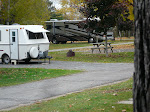 Two worlds of Recreational Vehicles colliding at Poplar Grove with a squirrel in the middle