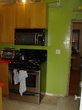 The kitchen side of the wall, with oen base cabinet and one wall cabinet already removed