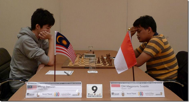 Wong Jianwen of Malaysia playing GM Megaranto Susanto of Indonesia, round 1, BCC 2013