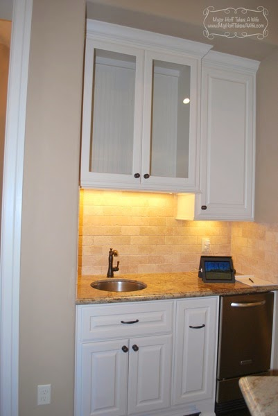 Wine corner with wine fridge bar sink and glass cabinet doors