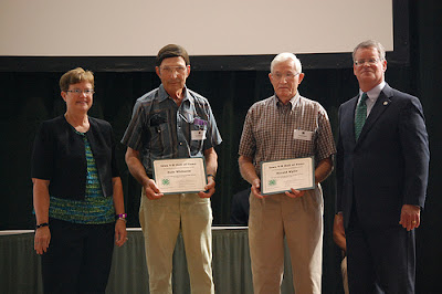 Washington County 4-H Alums Gale Whitacre (left) and Harold Wylie (right) are inducted into the Iowa 4-H Hall of Fame Sunday at the Iowa State Fair in Des Moines.  Photo courtesy of the Washington County Extension.