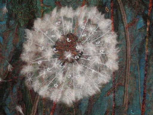 Dandelion by Svana Egilson. Woll, painted silk and other fabric, machine sewing and embroidery. The beauty of dandelion once it is in the shape of a bubble. The lightness and the tenderness is fascinating.