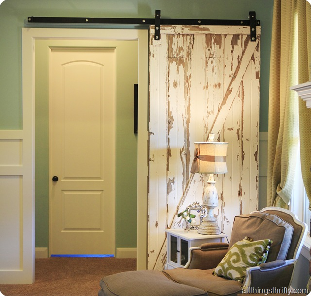 Interior decorating a living room jill s house reveal part 2 for Decorative interior barn doors
