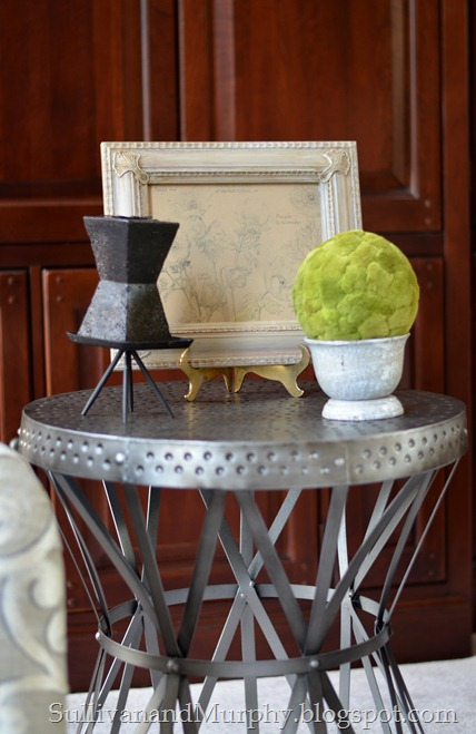 metal table with moss ball