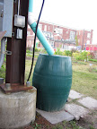 A rain water collection system is a green way to keep the plants well-watered.
