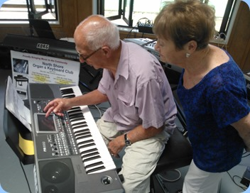 John Perkin setting-up a number on his Korg Pa900 whilst Diane Lyons observes closely.