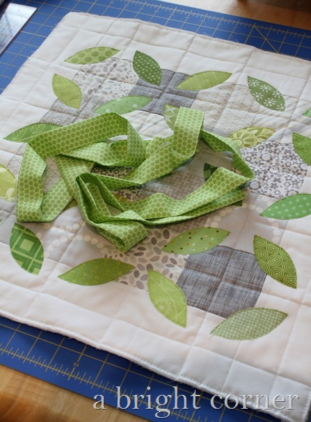 pillow with green binding