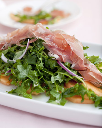 I bet this cantaloupe, arugula, and prosciutto salad is just as delicious as it looks.