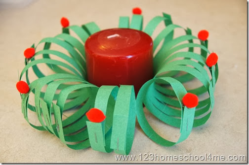 attached pom poms for decoration and set a candle in the middle
