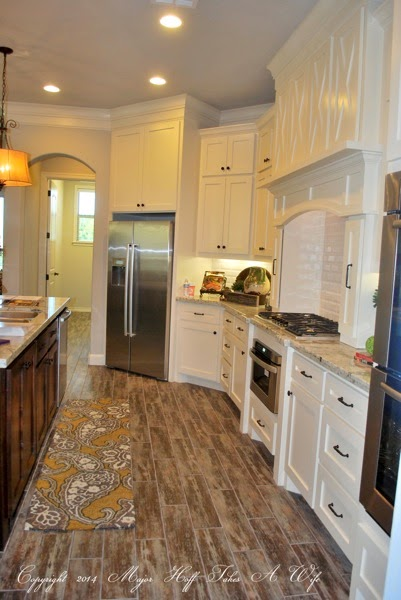 White kitchen with barn door styling and subway tile