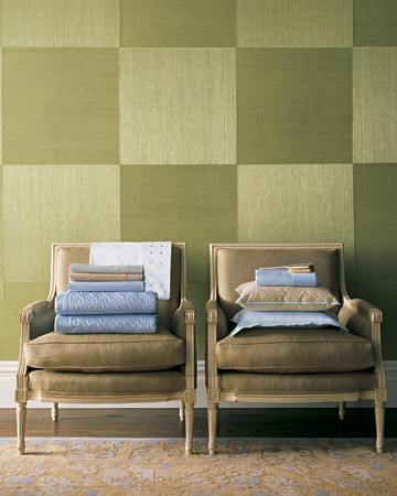 A grass-cut wall covering (cut into squares, with the pattern hung vertically and horizontally to achieve a checkerboard effect) creates a bedroom that is seductive yet not overwhelming.