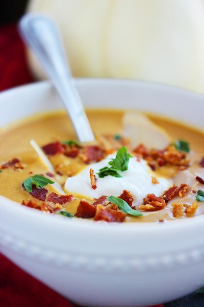 Creamy Pumpkin Soup – We love this spiced soup! It's delicious for weeknight meals or elegant holiday dinners! | thecomfortofcooking.com