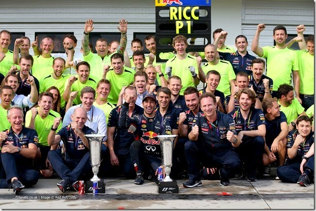 BUDAPEST, HUNGARY - JULY 27:  Daniel Ricciardo of Australia and Infiniti Red Bull Racing celebrates victory with his team and the trophy in the pit lane after the Hungarian Formula One Grand Prix at Hungaroring on July 27, 2014 in Budapest, Hungary.  (Photo by Mark Thompson/Getty Images) *** Local Caption *** Daniel Ricciardo