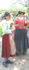 Plimoth Plant 2 pilgrim ladies w mugs in hand