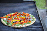 Once the toppings are arranged nicely, cover the grill and cook another 4-6 minutes, rotating the pizza halfway through so you get badass grill marks.