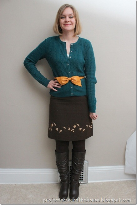 teal sweater, mustard belt, brown skirt, knee high boots