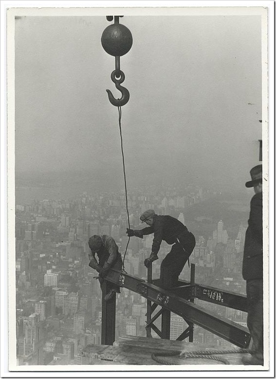 Two-workers-attaching-a-beam-with-a-crane-1931