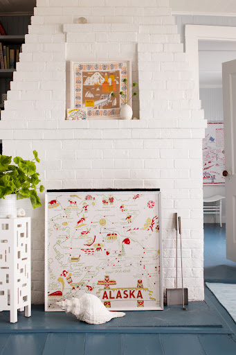 Displaying art is a great way to utilize a fireplace in the warmer months. (Martha Stewart Living, July 2010)