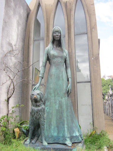A statue commerating Austrian avalanche victims Liliana Crociati de Szaszak and her dog.